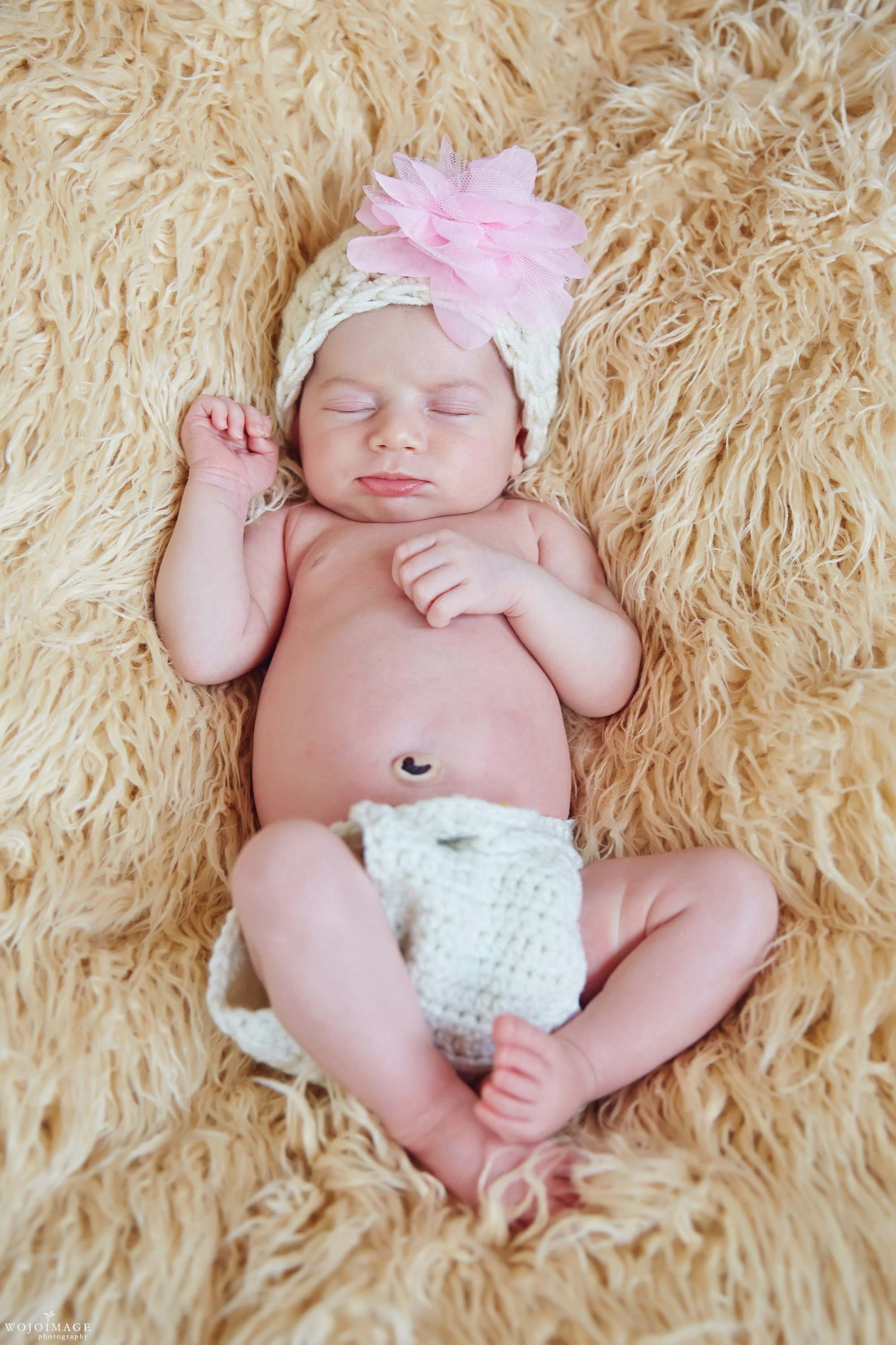 Natural Newborn Pose on a Furry Blanket