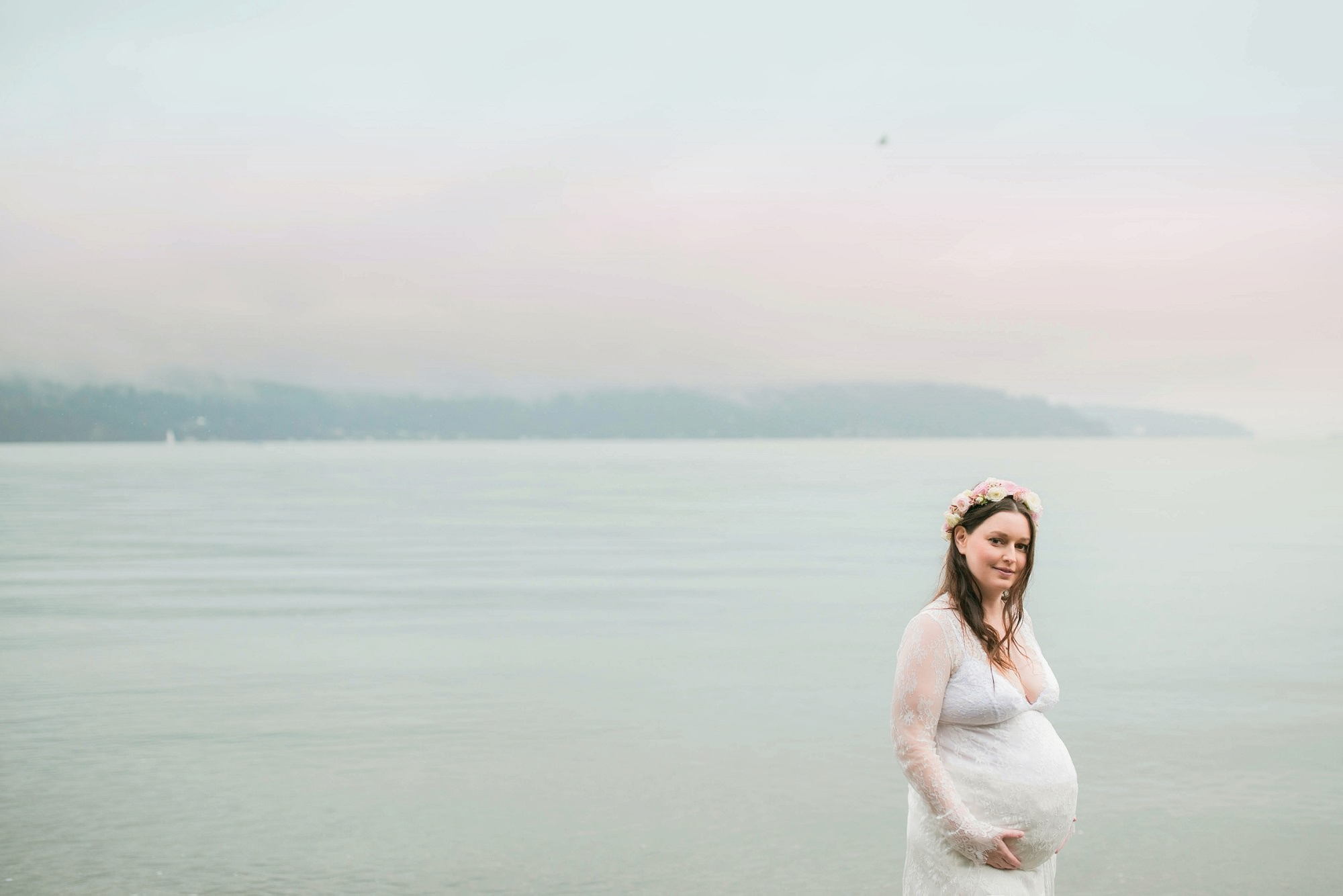 Pregnant Woman Wearing Floral Crown On The Beach
