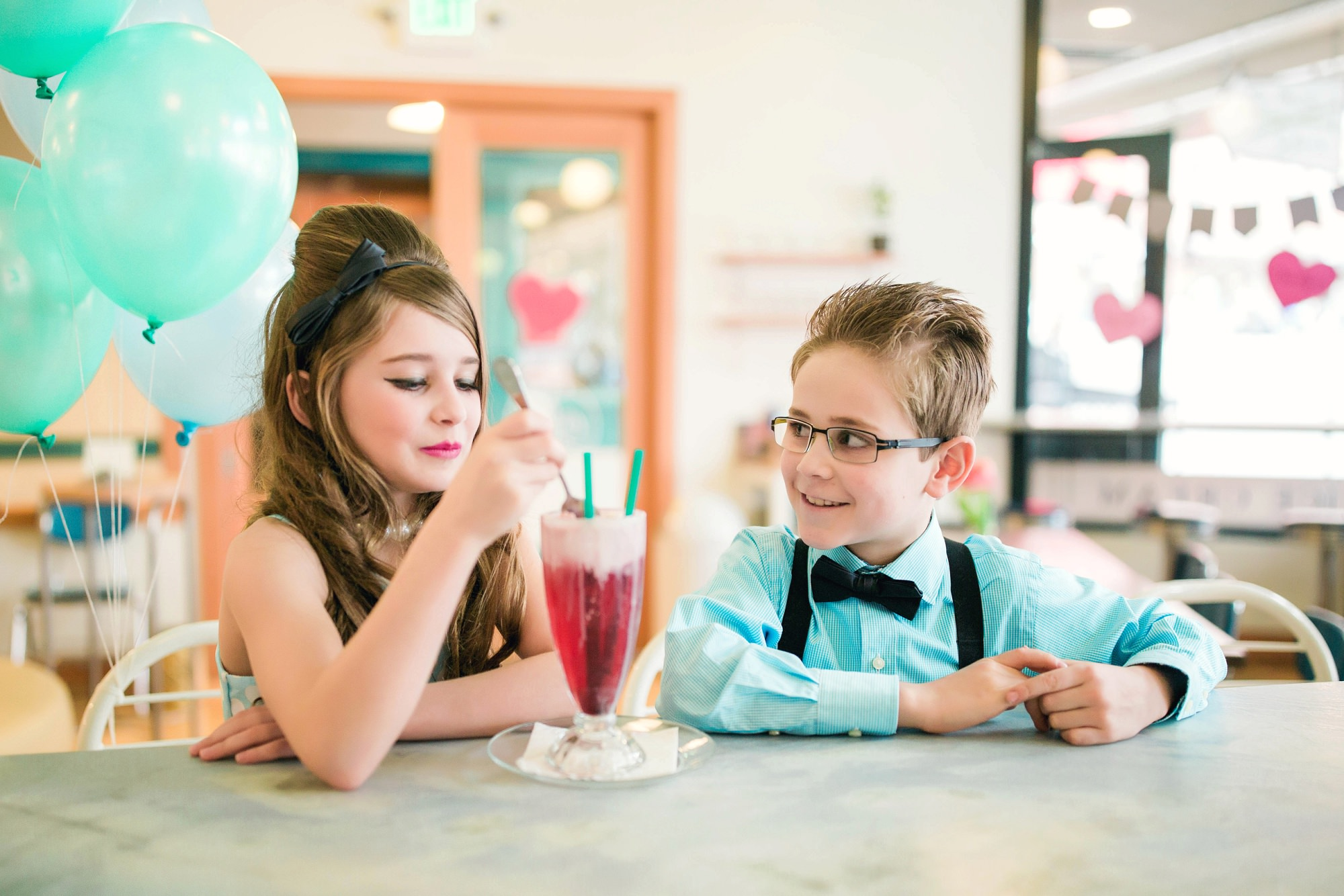 retro style kids photo shoot in an ice cream shop