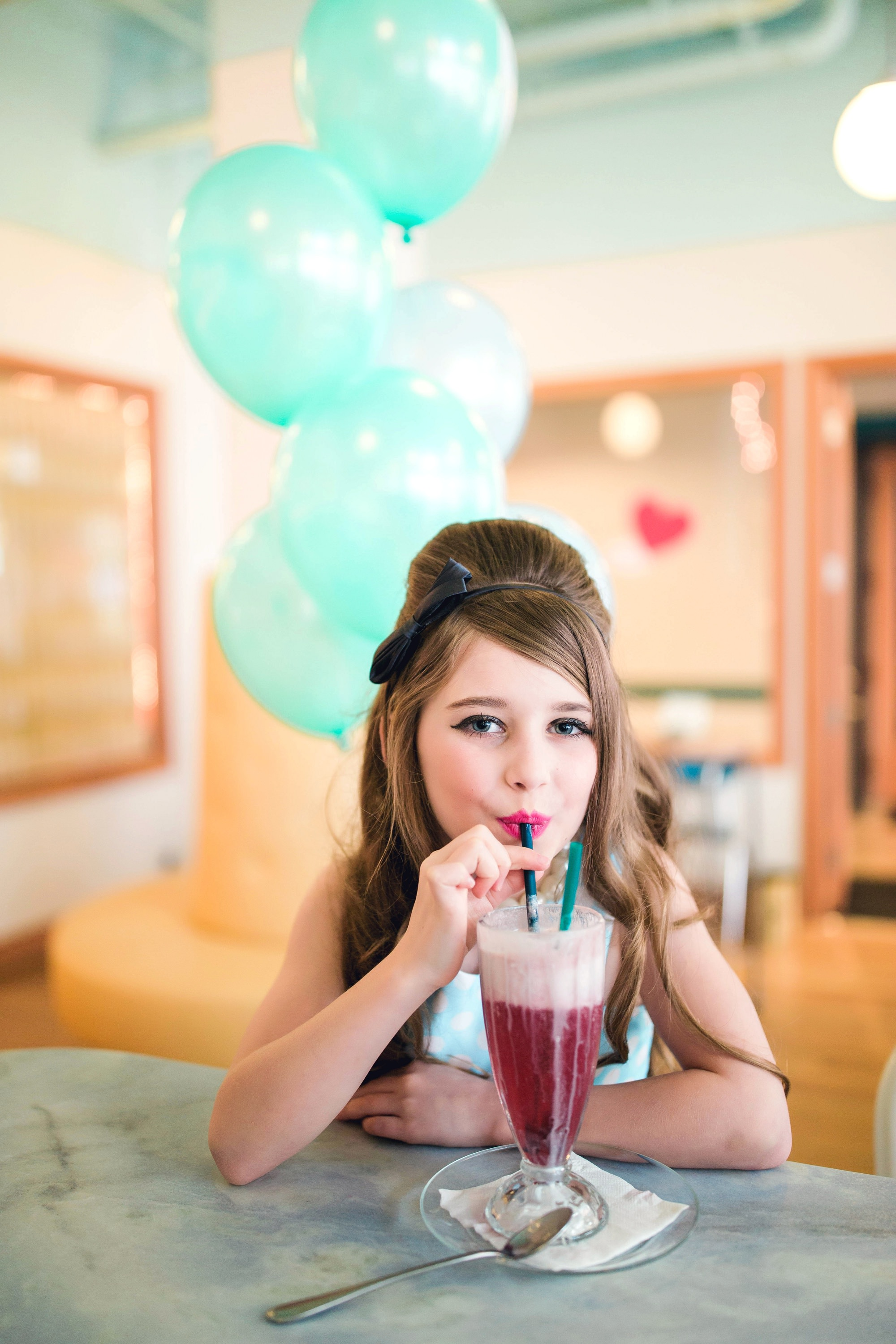 girl drinking a soda