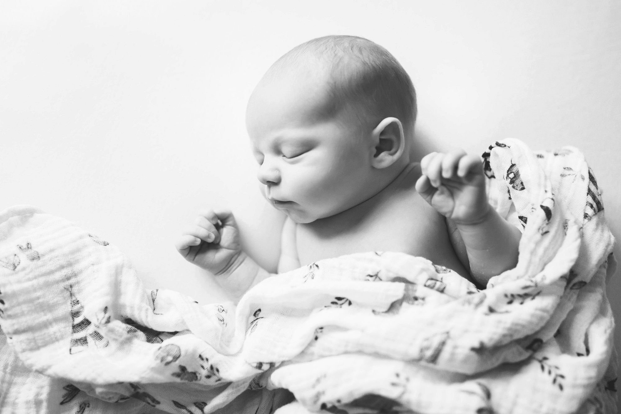 sleepy newborn baby natural pose