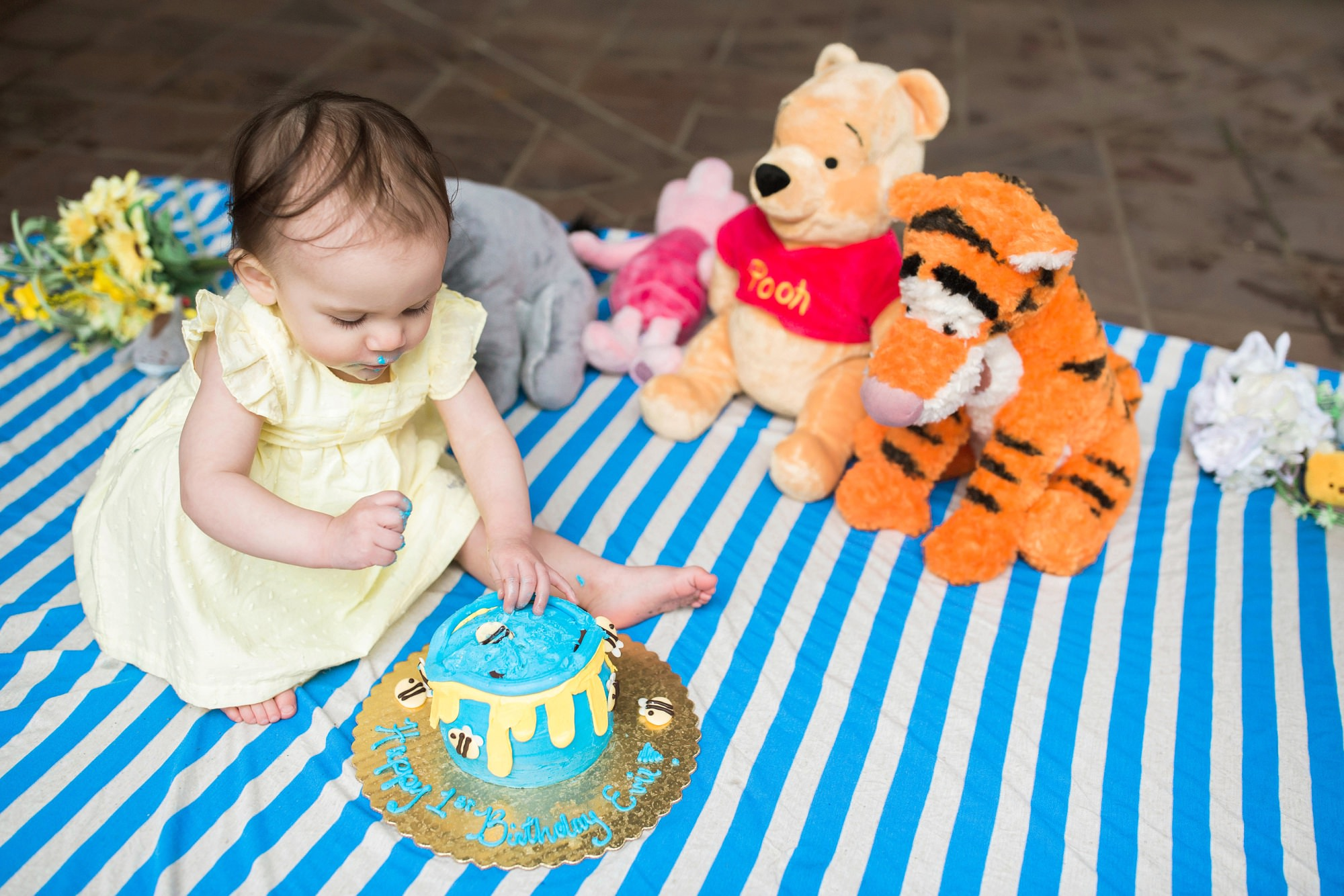 one year old girl smashing birthday care