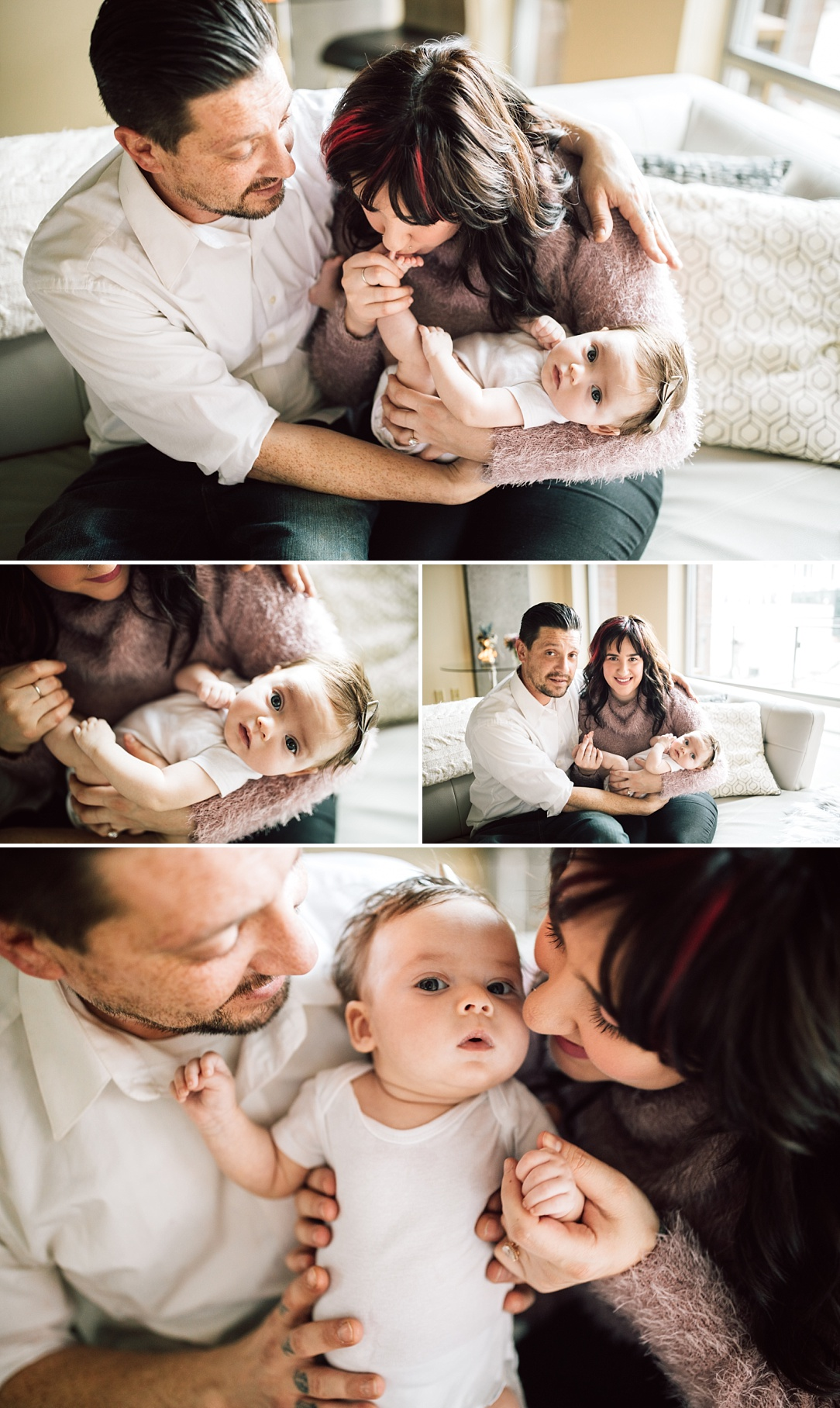 parents holding baby girl at home