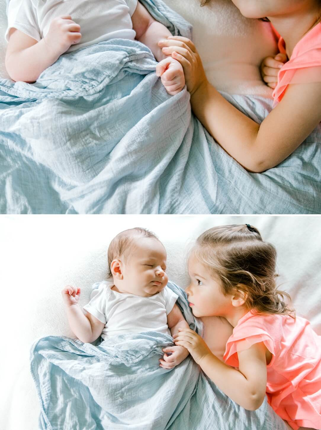 toddler girl and her newborn baby brother laying on bed at home