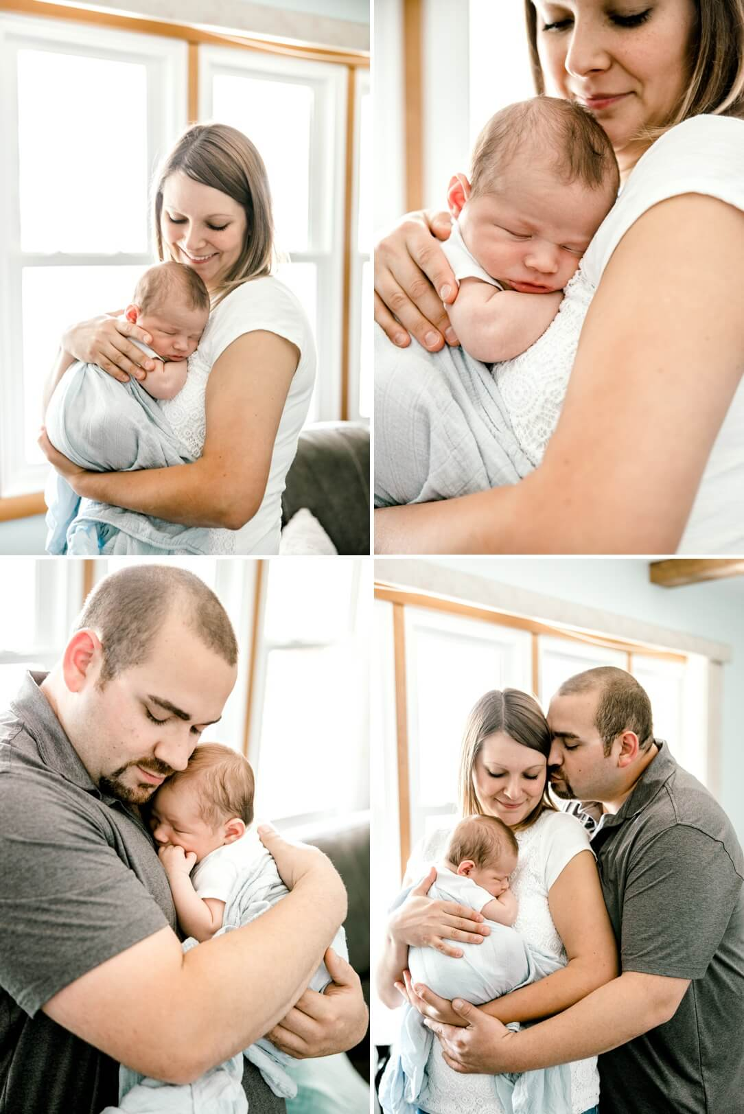 parents snuggling newborn baby boy in their living room at home