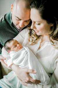 parents holding newborn baby
