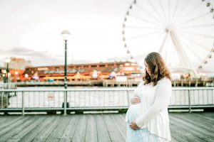 pregnant woman holding her belly by in downtown Seattle