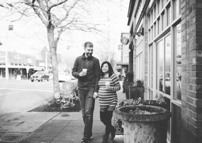 black and white maternity photo of a couple walking in Queen Anna Seattle